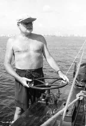 Ernest Hemingway wearing Gurkha style shorts whilst at sea, circa 1950s.