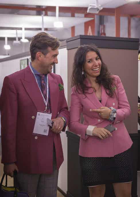 Chris Modoo attending Milano Unica 2017, wearing a raspberry VBC double-breasted jacket and accompanied by Valentina Berti of VBC.