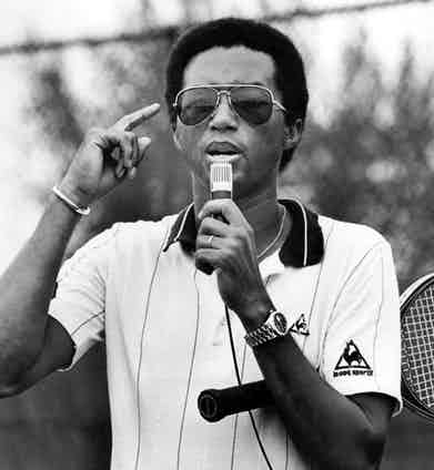 Arthur Ashe opts for a polo by Le Coq Sportif and his signature Rolex Day-Date 'Presidential', in 1981.