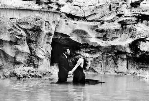The iconic scene in the Trevi Fountain between Marcello Mastroianni and Anita Ekberg's characters. Photo by Roger Viollet Collection/Getty Images.
