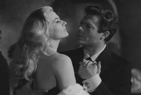 Large, circular polished cufflinks threaten to steal Ekberg's thunder in La Dolce Vita's dancing scene.