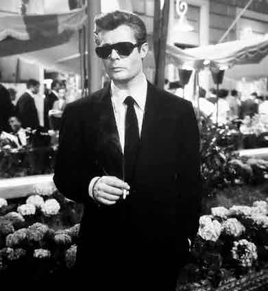One of Piero Gherardi's most emulated ensembles, topped off with the character's signature Persol shades.