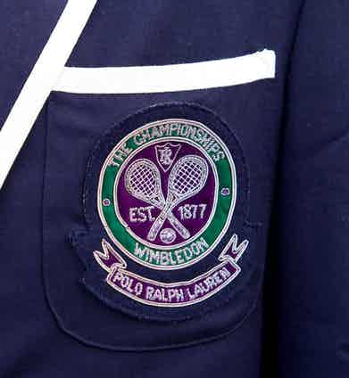 The Wimbledon logo embellished with 'Polo Ralph Lauren' on a linesman's blazer at the championships, 2011. Photo by Jeff Gilbert/Alamy.