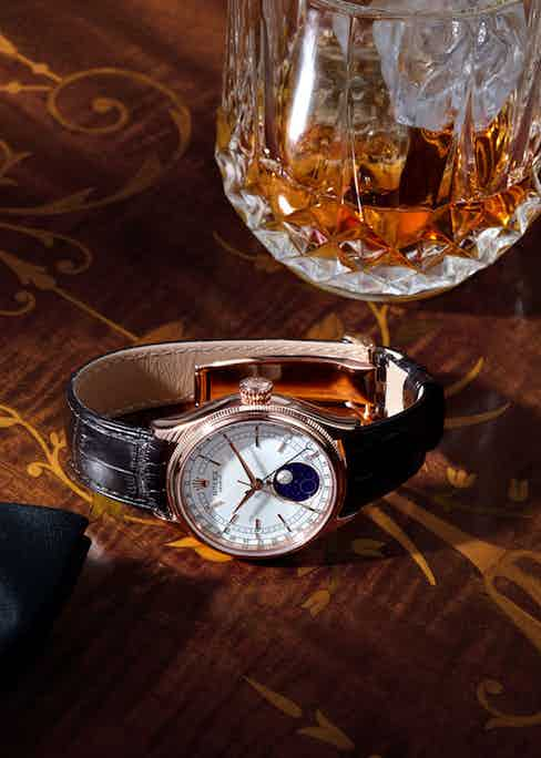 With a brown alligator strap and Everose gold case, the Cellini Moonphase is traditionally masculine and elegant.