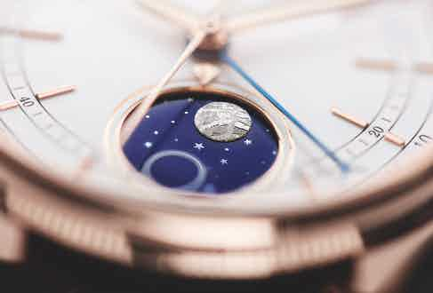 The white lacquer dial, 18 carat Everose gold case and blue enamel disc of Rolex's first moonphase complication.
