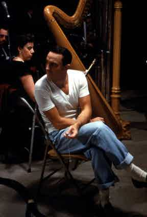 Gene Kelly relaxing in jeans and a white T-shirt on set of Summer Stock, 1950.