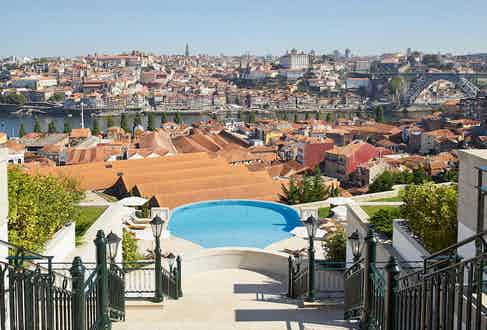 The view over the hotel's infinity pool looks over Porto and the Dom Luís bridge.