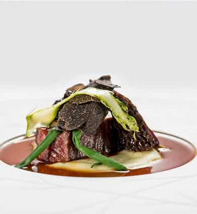 Grilled fillet of beef, potato cream, morel mushrooms and meat jus, a creation by the Michelin star chefs at The Yeatman.