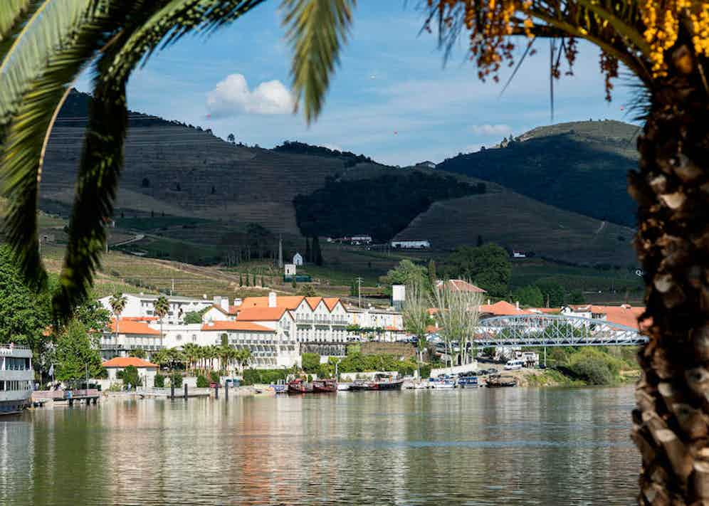 The Vintage House is nestled between vineyards, overlooking the Douro river.
