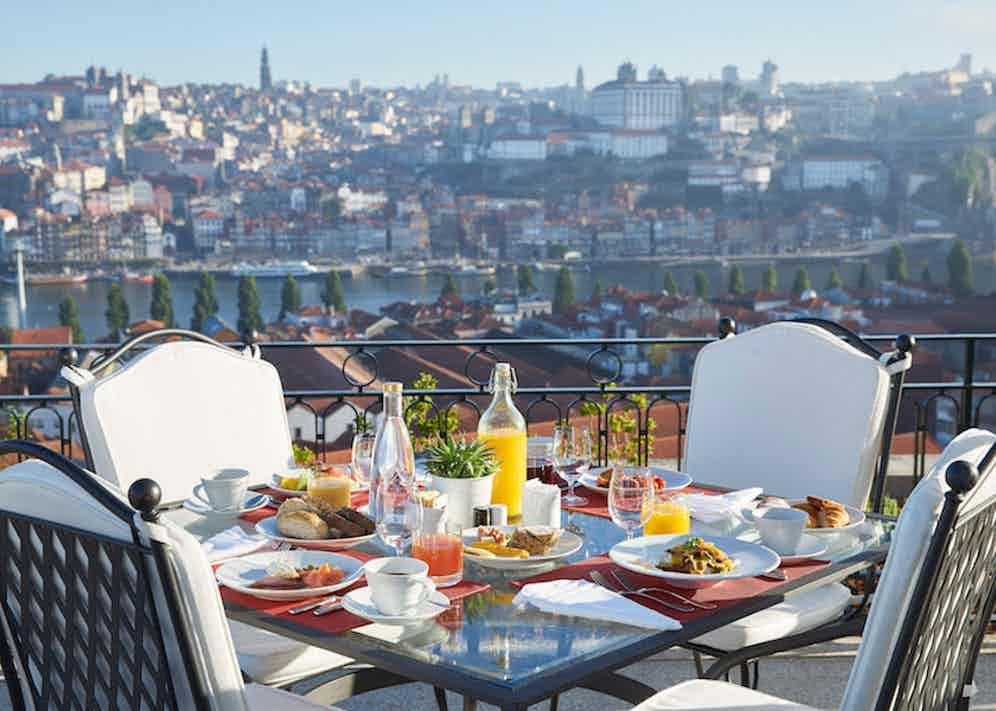 Breakfast is served in The Orangerie, with an outdoor area and stunning views over Porto.