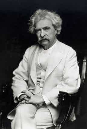 American Humorist and writer Mark Twain looks elegant and sophisticated in a white three piece, circa 1880. Photo by Granger/REX/Shutterstock.