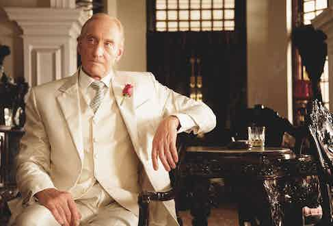 Charles Dance wears a tailored three piece white suit in a scene from Midnight's Children, 2012. Photo by Moviestore/REX_Shutterstock.