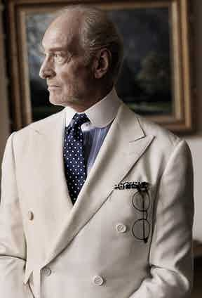 Charles Dance in Issue 40 of The Rake wears an ivory silk double-breasted suit, blue and white cotton striped shirt and navy and white spotted silk tie, all by Ralph Lauren Purple Label.
