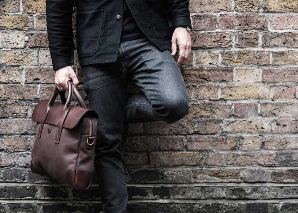The chocolate brown Bennett Winch Briefcase is made from 24oz canvas and vegetable-tanned leather.