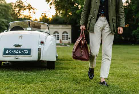 Grenfell's Green Cotton Shooter Jacket, Frank Clegg's Chestnut Signature Leather Travel Duffle and Carmina's Burgundy Cordovan Leather Double Monk Strap Shoes.