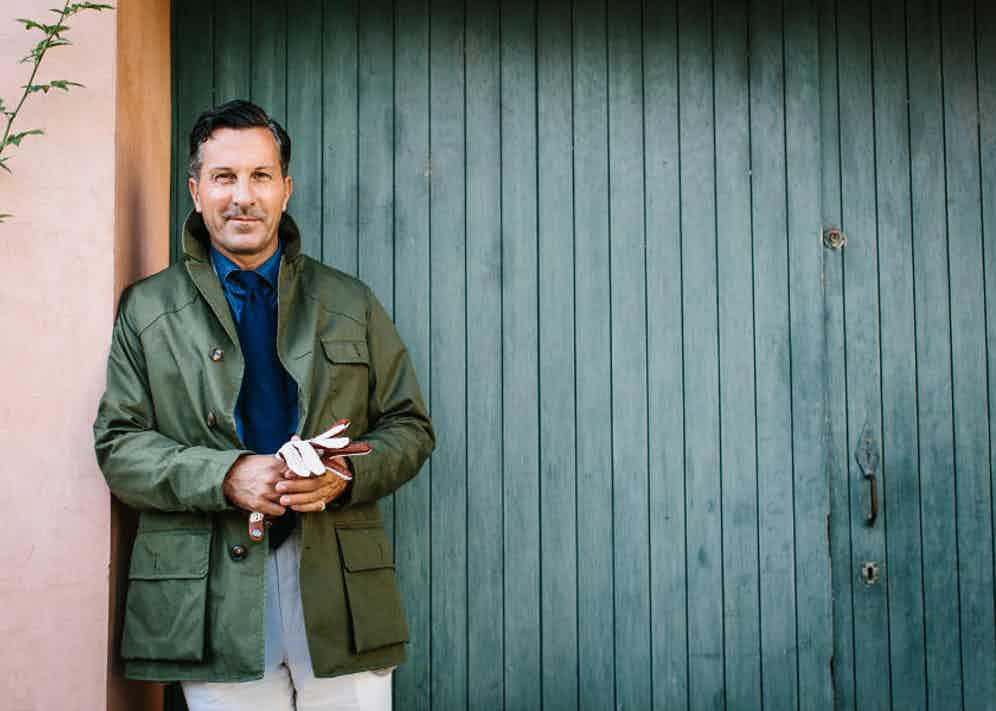Alexander Kraft wearing Grenfell's Green Cotton Shooter Jacket and Omega's Tan Driving Gloves.