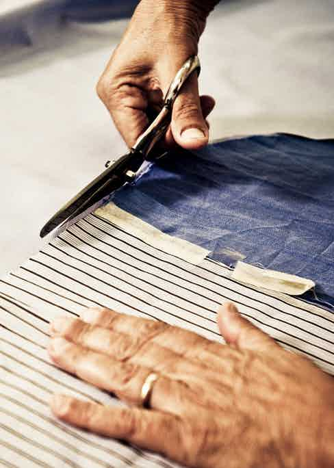 The hand-cutting of fabric in Santillo's atelier.