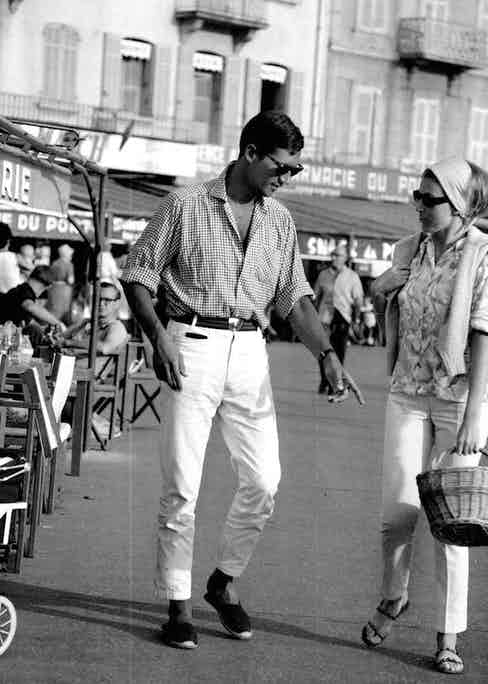A stylish couple displaying how to wear white trousers and summer footwear, circa 1950s.