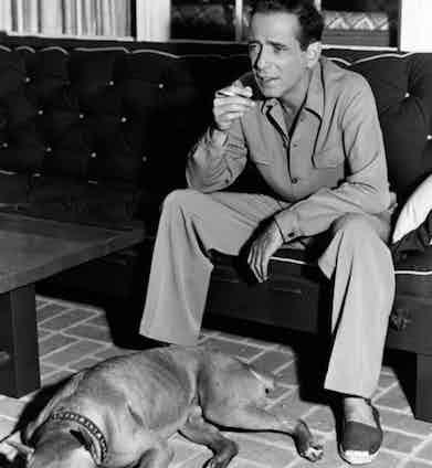 Humphrey Bogart combining a field shirt with espadrilles, circa 1940s.