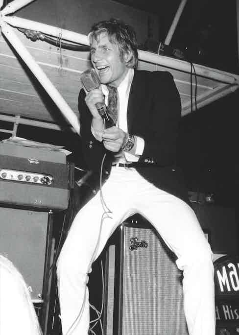 Singing on stage, circa 1960s.