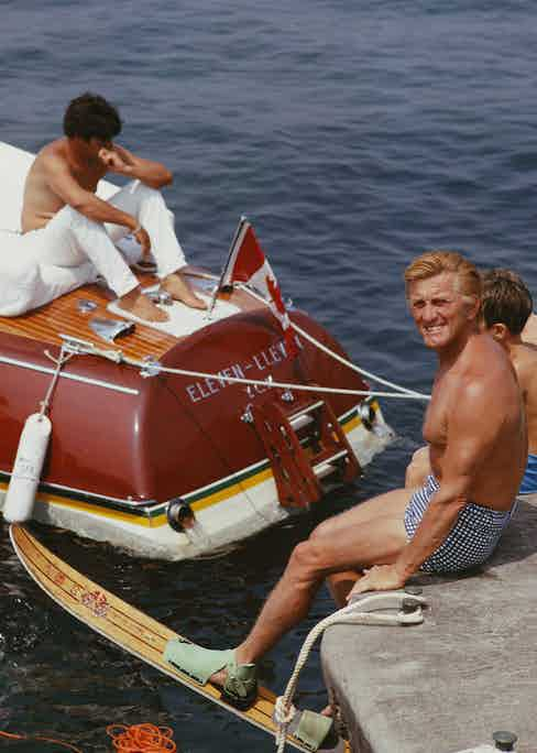 Kirk Douglas prepares to go water-skiing by the hotel in 1969. Photo by Slim Aarons.