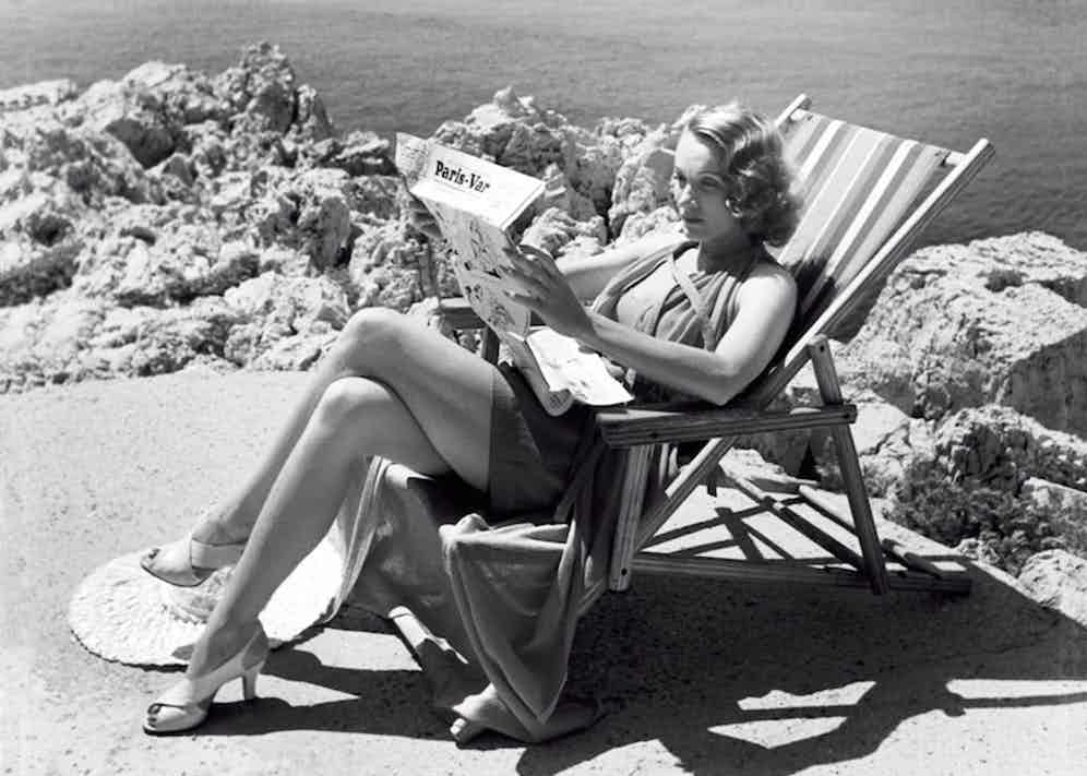Marlene Dietrich reading on the grounds of the hotel, circa 1940s.