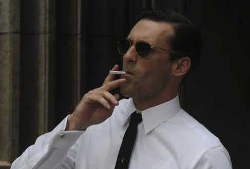 Don Draper's wire-framed sunglasses and narrow tie have an undeniably retro feel, paired with French cuffs on a crisp white shirt and an ever-present cigarette.
