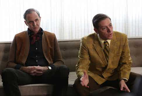 A very 1960s palette of ochre, tan and mustard yellow prevails in the show. Here, Frank Gleason's brown cardigan over a black button down shirt is no match for Ted Chaough's bold jacket and matching tie.