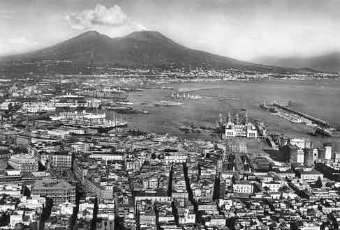 Napoli harbour port with Mount Vesuvius in the background in June, 1940 before it was bombed during the Second World War. Photo by David Bagnall/REX/Shutterstock.