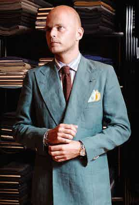 Luca Rubinacci says 'having the buttons rolled low on a double-breasted jacket lends it an easier feel. I tend to button it to the higher button when I need to dress more formally'. The high gorge of the lapel, darts in the chest, boat-shaped breast pocket and backstitch detailing are signature design traits of the house of Rubinacci.