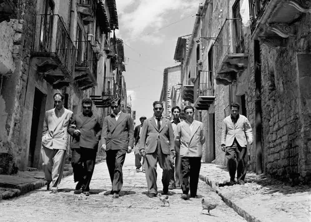 'Lucky' Luciano (third right) walking with his henchmen in Sicily, Italy, 1948. Photo by Slim Aarons/Getty Images.