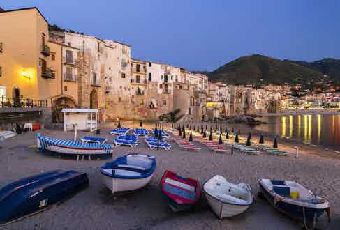 Boats on the beach and harbour in the historic centre of Cefalu, a Province of Palermo, Sicily. Photo by Martin Jung/imageBROKER/REX/Shutterstock.