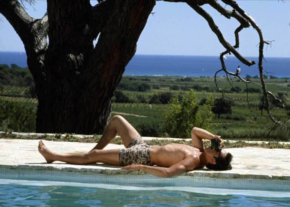 Alain Delon lounging by the pool in La Piscine, 1969.
