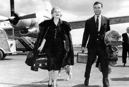 Porfirio Rubirosa and Zsa Zsa Gabor at Orly Airport on their way to the Cannes Film Festival in 1955.