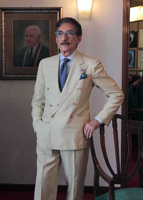 A. Caraceni's son-in-law Carlo Andreacchio continues the family legacy with a transformable off-white double-breasted suit. The pockets are placed high on the hip, and the buttons are at an angle (rather than the middle button being placed directly above the lower).