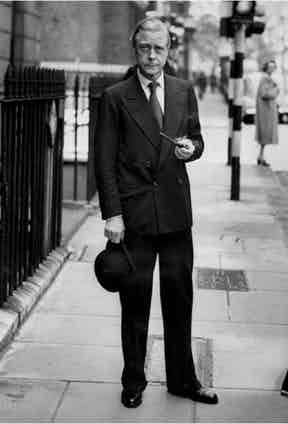 """The Duke of Windsor on Savile Row in the 1930s. The long lapel has a lengthening effect on the 5'8"""" monarch's height, while the bottom row of buttons aligns with the hip pockets, a signature in Frederick Scholte's tailoring."""