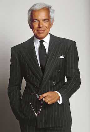 Ralph Lauren is a master at the 6x1 jacket style, here imagined in a strong charcoal pinstripe fabric. The long lapel line created by the 6x1 elongates the torso and gives the impression of greater height, which, coupled with the heavily padded shoulders of this coat, creates a highly masculine V-shape silhouette.