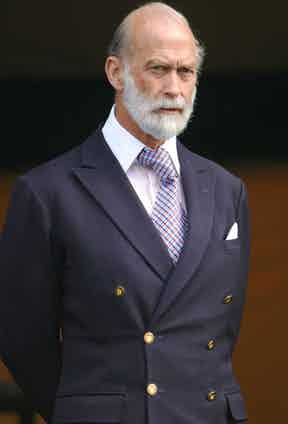 Prince Michael of Kent's penchant for the double-breasted suit is expressed with generous proportions and an old-school character. Here, he wears a transformable 6x2 jacket, which he has buttoned on the middle and bottom. This style could be worn on just the bottom however, which he often does. His over-sized Windsor tie knot is a playful transgression from tradition, juxtaposed with the classic suit style.