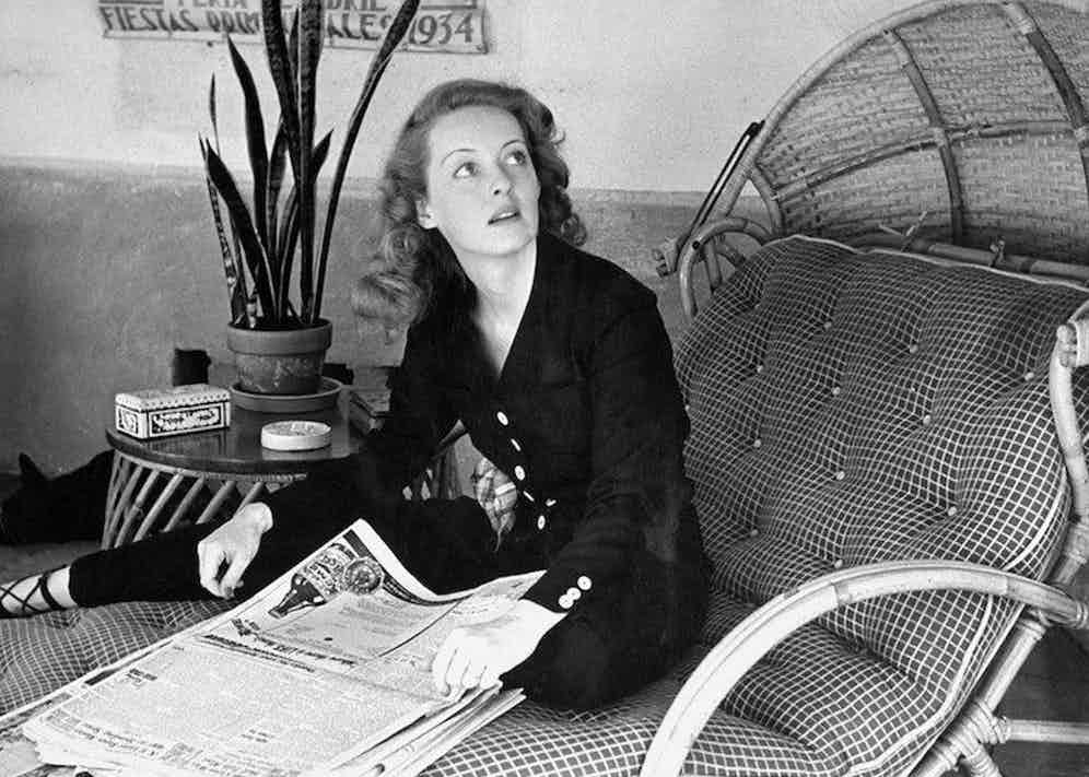 Looking chic whilst skimming the morning papers at home, 1939.