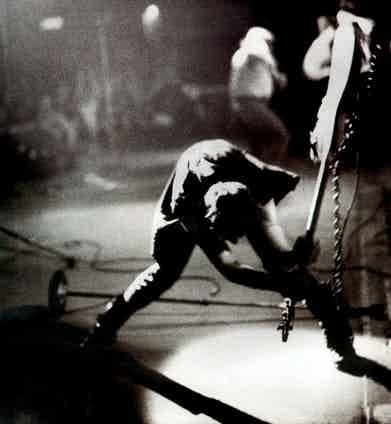 The iconic image of Simonon smashing his guitar, as captured by Pennie Smith in the late 1970s.