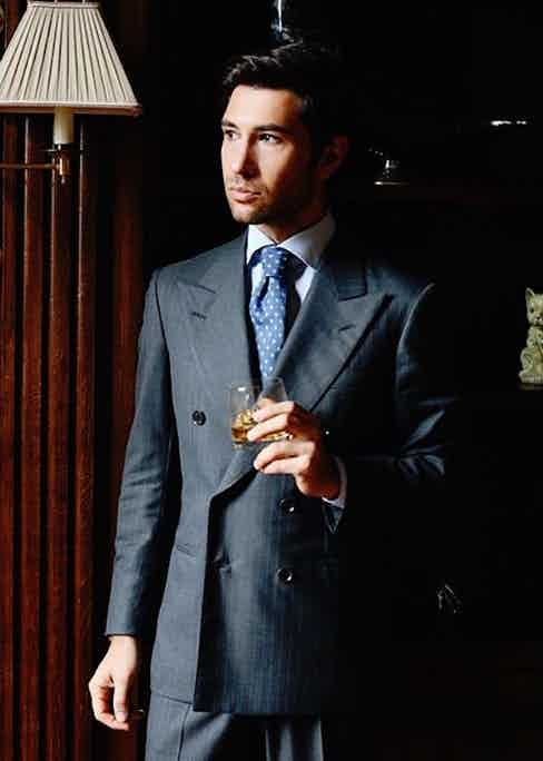 Filippo Fiora wearing a double-breasted A. Caraceni pinstriped suit in VBC wool.
