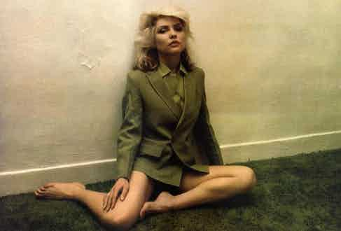 Debbie Harry dons a double-breasted military-inspired jacket, circa 1976.