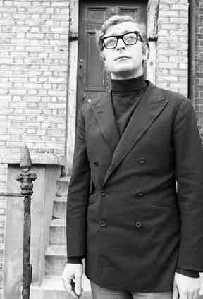 Michael Caine visits Erlwin Street, Camberwell, where he once lived as part of TV documentary Candid Caine, 1969. Photo by ITV/REX/Shutterstock.