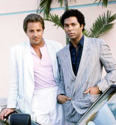 Don Johnson and Philip Michael Thomas, as detectives James 'Sonny' Crockett and Ricardo Tubbs, in a promotional portrait for the TV series 'Miami Vice', circa 1985. Photo by Silver Screen Collection/Getty Images.