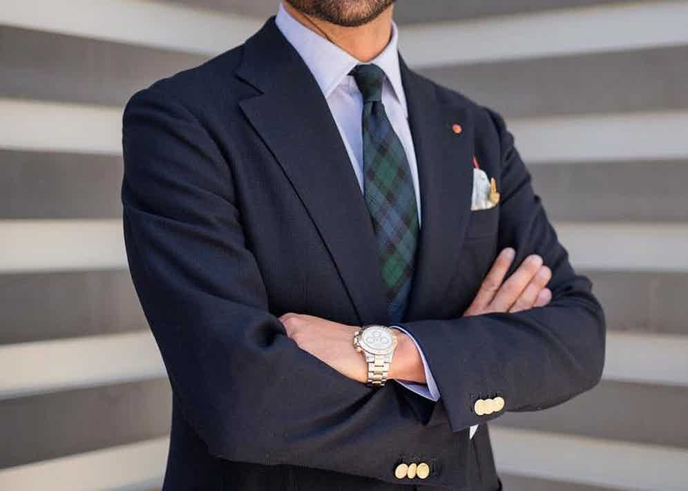 Giorgio Giangiulio takes a more subtle approach to the pattern, incorporating it into his accessories with a green and blue tartan tie.