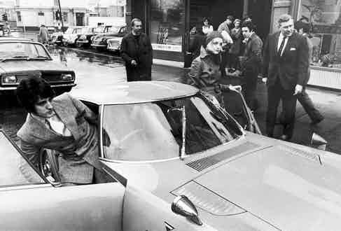 An 18-year-old Twiggy and Justin getting into her new Toyota 2000 GT sports car, a gift from the Japanese car company in 1968. Photo by Keystone/Hulton Archive/Getty Images.