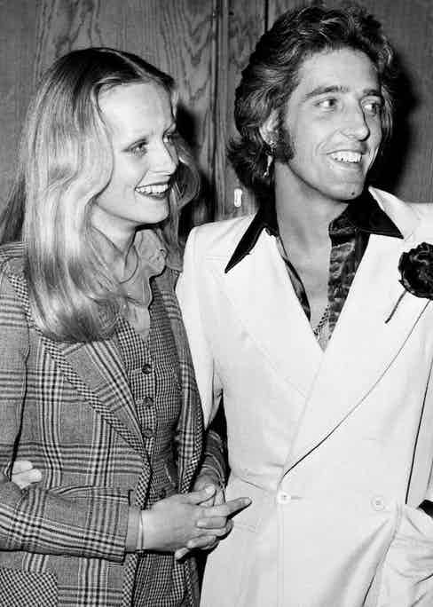 Twiggy with Justin de Villeneuve both wearing bespoke Nutter's of Savile Row suits at a press conference announcing their plans to produce musical film 'Gotta Sing, Gotta Dance', 1973. Photo by Ian Showell/Keystone/Getty Images.