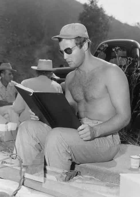 Brando goes over his script during location filming for Julius Caesar, 1953.