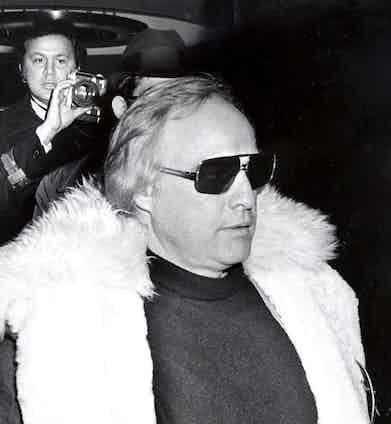 Marlon Brando trying to escape Galella's lens, 1974.