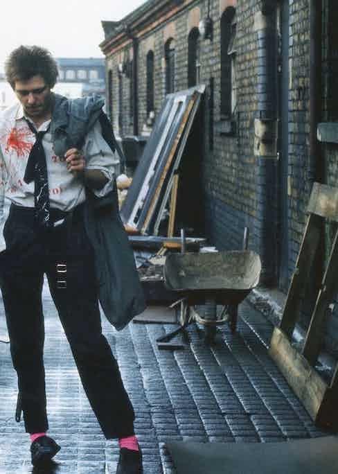 Paint splatters and clashing pink socks make a sartorial statement, 1977.